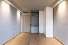 Front view of modern room with large wardrobe. Nobody inside royalty free stock photos