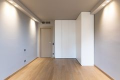 Front view of modern room with large wardrobe. Nobody inside royalty free stock image