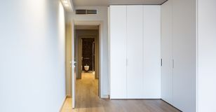 Front view of modern room with large wardrobe stock photo