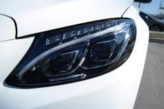 Front view modern tecnology car head light. Front view of modern tecnology car head light stock photography