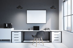 Front view of modern workspace with computer. Front view of a modern workplace at home or in an office. There is a long writing table, a laptop, a horizontal Royalty Free Stock Photos