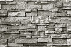 Front view of monotone grey rough stone wall for background or banner. Front view of monotone grey rough stone wall for Texture background or banner stock photography