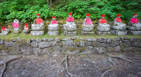 Front view of moss covered statues of Jizo in Nikko Royalty Free Stock Photos