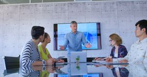 Multi-ethnic business people discussing with his coworkers in modern office 4k. Front view of multi-ethnic business people discussing with his coworkers in stock footage