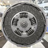 Front view of new composite clutch disc inside open housing for trucks and tractors. New friction pads. Clutch repair kit. Car mai Royalty Free Stock Image