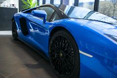 Front view of a new Lamborghini Aventador S coupe. Headlight. Car detailing. Car exterior details stock photography