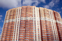 Front view of new modern multistoried residential brick building Royalty Free Stock Images