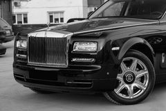 Front view of new a very expensive luxury Rolls Royce Phantom car, a long black limousine, model outdoors, prepared for sale in royalty free stock image