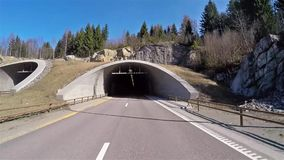 Front view of Norway highway road entering tunnel. Front view of car on norway highway road entering tunnel stock video