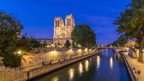 Front view of Notre Dame De Paris cathedral day to night timelapse after sunset. Front view of illuminated Notre Dame De Paris cathedral day to night transition stock video