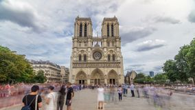 Front view of Notre-Dame de Paris timelapse hyperlapse, a medieval Catholic cathedral on the cite island in Paris. Front view of Notre-Dame de Paris timelapse stock video