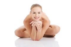 Front view nude woman sitting propping head Stock Photos