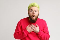 Free Front View Of Astonished Man In Casual Sweater Standing With Mouth Open In Surprise, Has Shocked Expression, Hears Unbelievable Stock Photography - 217089282