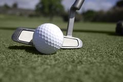 Front View Of Golf Ball And Putter Behind Ball Royalty Free Stock Photo
