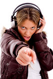 Front View Of Pointing Woman Enjoying Music Royalty Free Stock Photos