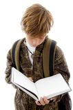 Front View Of School Child Reading Royalty Free Stock Photography