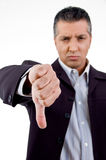 Front View Of Unhappy Boss Showing Thumb Down Stock Photography