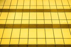 Front view of office building windows, Multiple closed windows on a large office building, cool business background and refection royalty free stock image