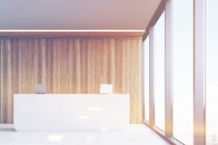 Front view, office reception, wood panels, toned Stock Photo