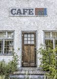 Front view of old abandoned cafe with a beautiful old wood door Stock Image