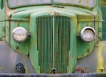 Front view of an old abandoned green rusty 1940s truck. A front view of an old abandoned green rusty 1940s truck stock image