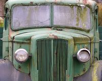 Front view of an old abandoned green rusty 1940s truck. A front view of an old abandoned green rusty 1940s truck stock images