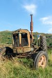 Front view of an old abandoned rusty agricultural tractor in a g royalty free stock photography