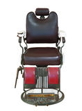 Front view of old barber chair isolated on white with clipping p Royalty Free Stock Photo