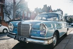 Front view of old blue Mercedes-Benz 600 parked in London, UK, on a sunny day. London, UK - February 23, 2019: Front view of old blue Mercedes-Benz 600 parked on stock photos