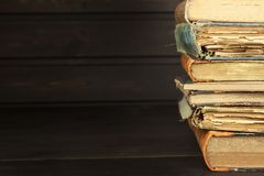 Front view of old books stacked on a shelf. Books without title and author. Old books in the university library. Books to study. Preparation for the exam in stock image