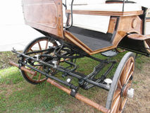 Front view of old-fashioned horse carriage on green grass Stock Image