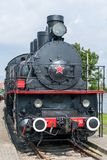 Front view of an old-fashioned steam locomotive. royalty free stock photo