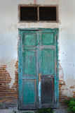 Front View of Old Grunge Green Wood Door Royalty Free Stock Image