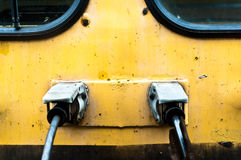 Front view of an old train. Yellow train front view with windows royalty free stock photography