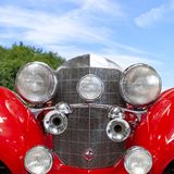 Front view of an old vintage classic red car stock image