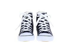 Pair of womens high top lace up dark navy blue sneakers isolated on white background Royalty Free Stock Photo