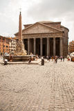 Front view of the Pantheon. In Rome Italy. Tourists are going to walk towards the Pantheon royalty free stock image