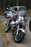 Front view of parked motorcycles Yamaha XV 1700 Road Star Silverado and Kawasaki Vulcan VN 1500 in cloudy day Royalty Free Stock Photo