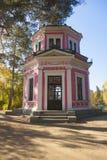 Front view of pavilion in autumn park. Front view of pink pavilion in autumn park Royalty Free Stock Photo