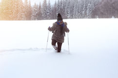 Front view of a person walking through deep snow Stock Photos