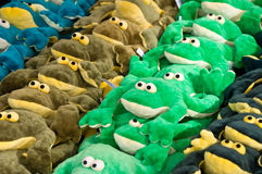 Front view piled toy frogs Stock Photography