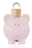 Front view of pink piggy bank and padlock Stock Images