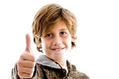 Front view of pleased kid with thumbs up Royalty Free Stock Image