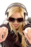 Front view of pointing female enjoying music Stock Photography