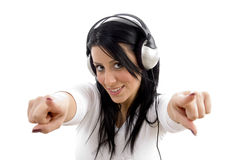 Front view of pointing female wearing headphone Royalty Free Stock Photography
