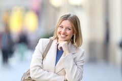 Confident woman looking at camera standing in the street royalty free stock image