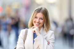 Portrait of a confident woman looking at you. Front view portrait of a confident woman looking at you on the street in winter Stock Photo