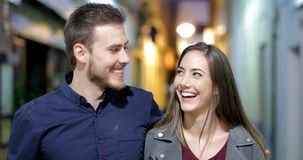 Happy couple walking and talking in the night stock footage