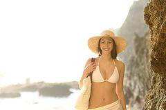 Happy tourist in bikini looks at you on the beach royalty free stock images
