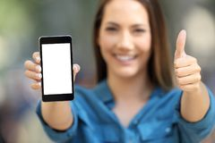 Positive woman showing a blank smart phone screen Stock Photography